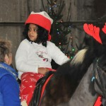 Child in Christmas pyjamas on pony