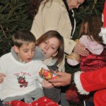 Father Christmas giving child a present