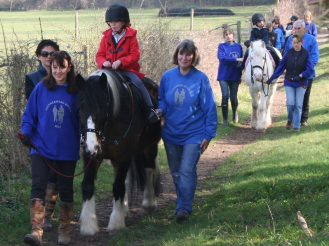3 children on ponies riding out in the country