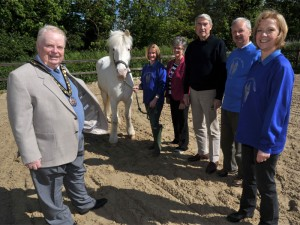 Mayor and Mayoress of Elmbridge with grey horse and volunteers from Leatherhead and Horsley and Bookham RDA Groups